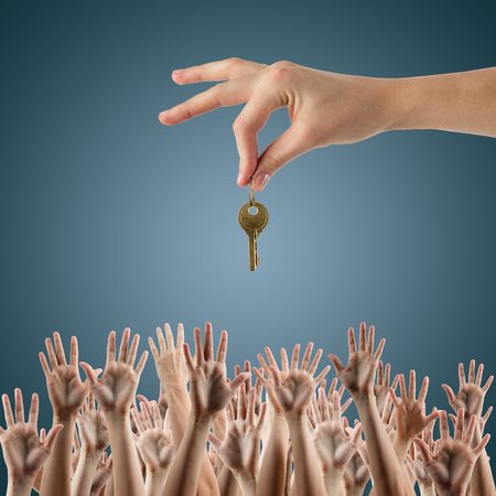 Multiple offers on a home with hands in the air winning a key